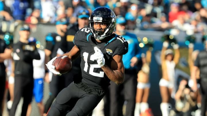 JACKSONVILLE, FLORIDA - DECEMBER 16: Dede Westbrook #12 of the Jacksonville Jaguars runs for yardage during the game at TIAA Bank Field on December 16, 2018 in Jacksonville, Florida. (Photo by Sam Greenwood/Getty Images)