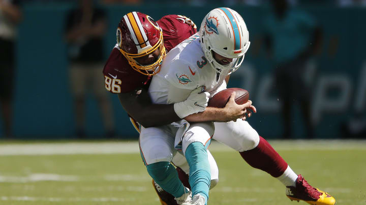 MIAMI, FLORIDA - OCTOBER 13:  Treyvon Hester #96 of the Washington Redskins sacks Josh Rosen #3 of the Miami Dolphins during the first quarter at Hard Rock Stadium on October 13, 2019 in Miami, Florida. (Photo by Michael Reaves/Getty Images)
