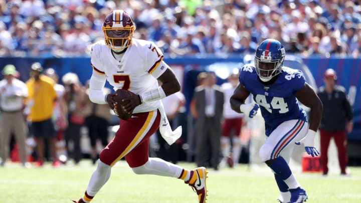 EAST RUTHERFORD, NEW JERSEY - SEPTEMBER 29: Dwayne Haskins #7 of the Washington Redskins runs with the ball against Markus Golden #44 of the New York Giants during the second quarter in the game at MetLife Stadium on September 29, 2019 in East Rutherford, New Jersey. (Photo by Al Bello/Getty Images)