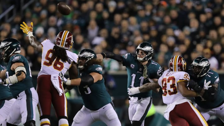 PHILADELPHIA, PA - DECEMBER 03:  Quarterback Carson Wentz #11 of the Philadelphia Eagles gets a pass off under pressure against the Washington Redskins during the second quarter at Lincoln Financial Field on December 3, 2018 in Philadelphia, Pennsylvania.  The Philadelphia Eagles won 28-13. (Photo by Elsa/Getty Images)