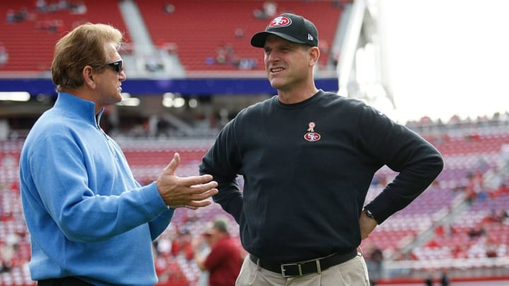 SANTA CLARA, CA - NOVEMBER 23: Head Coach Jim Harbaugh of the San Francisco 49ers talks with broadcaster Joe Theismann on the field prior to the game against the Washington Redskins at Levi Stadium on November 23, 2014 in Santa Clara, California. The 49ers defeated the Redskins 17-13. (Photo by Michael Zagaris/San Francisco 49ers/Getty Images)