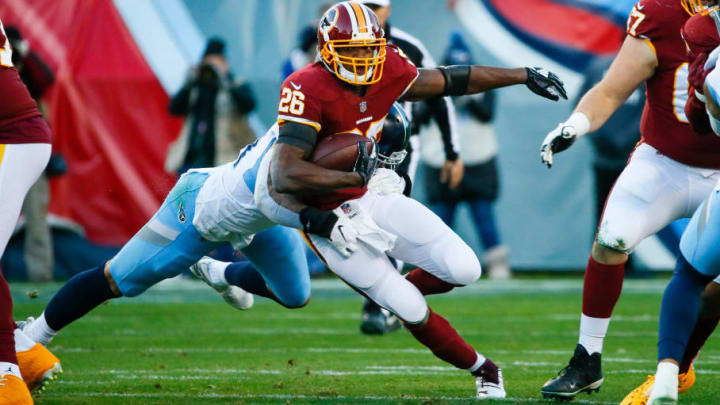 NASHVILLE, TN - DECEMBER 22: Adrian Peterson #26 of the Washington Redskins is tackled by Kamalei Correa #44 of the Tennessee Titans during the second quarter at Nissan Stadium on December 22, 2018 in Nashville, Tennessee. (Photo by Frederick Breedon/Getty Images)