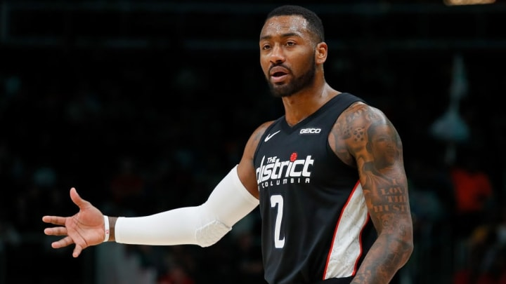 ATLANTA, GEORGIA - DECEMBER 18:  John Wall #2 of the Washington Wizards reacts after Markieff Morris #5 was charged with his sixth foul against the Atlanta Hawks at State Farm Arena on December 18, 2018 in Atlanta, Georgia.  NOTE TO USER: User expressly acknowledges and agrees that, by downloading and or using this photograph, User is consenting to the terms and conditions of the Getty Images License Agreement. (Photo by Kevin C.  Cox/Getty Images)