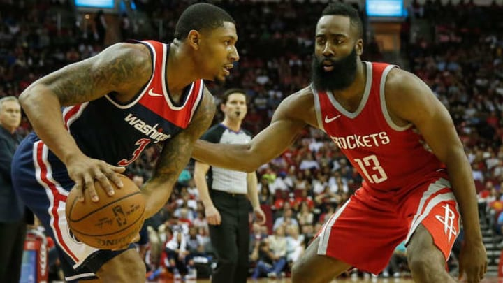 HOUSTON, TX - APRIL 03:  James Harden #13 of the Houston Rockets defends against Bradley Beal #3 of the Washington Wizards in the second half at Toyota Center on April 3, 2018 in Houston, Texas.  NOTE TO USER: User expressly acknowledges and agrees that, by downloading and or using this Photograph, user is consenting to the terms and conditions of the Getty Images License Agreement.  (Photo by Tim Warner/Getty Images)