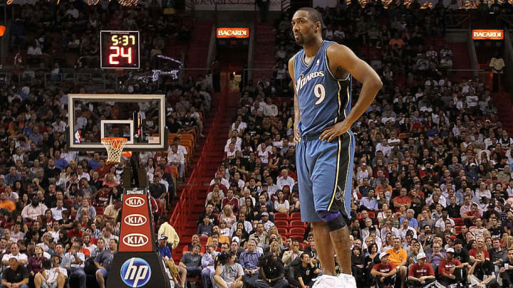 MIAMI, FL - NOVEMBER 29:  Gilbert Arenas #9 of the Washington Wizards looks on during a game against the Miami Heat at American Airlines Arena on November 29, 2010 in Miami, Florida. NOTE TO USER: User expressly acknowledges and agrees that, by downloading and/or using this Photograph, User is consenting to the terms and conditions of the Getty Images License Agreement.  (Photo by Mike Ehrmann/Getty Images)