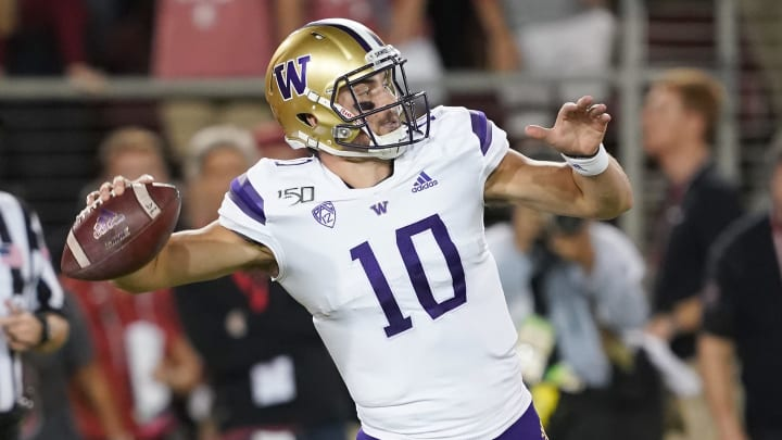 PALO ALTO, CALIFORNIA - OCTOBER 05: Jacob Eason #10 of the Washington Huskies throws a pass against the Stanford Cardinal during the first quarter of an NCAA football game at Stanford Stadium on October 05, 2019 in Palo Alto, California. (Photo by Thearon W. Henderson/Getty Images)