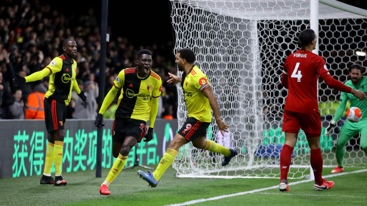 Watford players celebrate as Virgil van Dijk and Alisson can only watch on