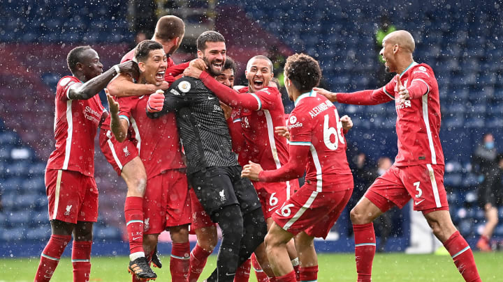 Alisson mobbed by teammates.
