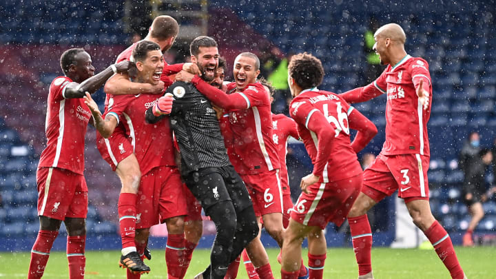 Liverpool celebrate Alisson's winner against West Brom