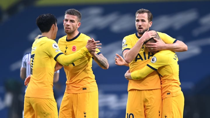 Tottenham players celebrate their last-ditch victory over West Brom