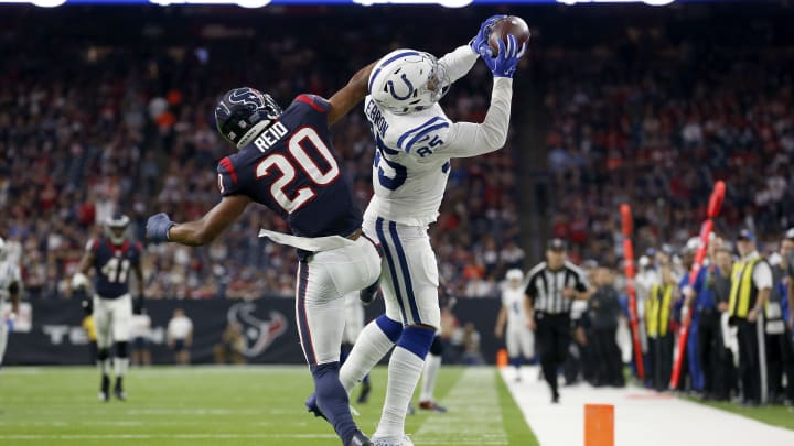 HOUSTON, TX - JANUARY 05:  Eric Ebron #85 of the Indianapolis Colts catches a pass in the second quarter defended by Justin Reid #20 of the Houston Texans during the Wild Card Round at NRG Stadium on January 5, 2019 in Houston, Texas.  (Photo by Tim Warner/Getty Images)