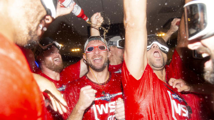 WASHINGTON, DC - OCTOBER 01: Max Scherzer #31 of the Washington Nationals celebrates with teammates after the Washington Nationals defeated the Milwaukee Brewers for the National League Wild Card game at Nationals Park on October 1, 2019 in Washington, DC. (Photo by Will Newton/Getty Images)