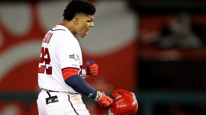 WASHINGTON, DC - OCTOBER 01:  Juan Soto #22 of the Washington Nationals celebrates after driving in three runs against the Milwaukee Brewers during the eighth inning of the National League Wild Card game at Nationals Park on October 01, 2019 in Washington, DC.at Nationals Park on October 01, 2019 in Washington, DC. (Photo by Rob Carr/Getty Images)