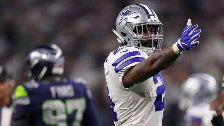 ARLINGTON, TEXAS - JANUARY 05: Ezekiel Elliott #21 of the Dallas Cowboys gestures for a first down against the Seattle Seahawks in the fourth quarter during the Wild Card Round at AT&T Stadium on January 05, 2019 in Arlington, Texas. (Photo by Tom Pennington/Getty Images)