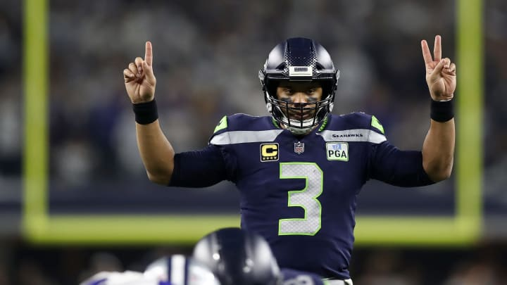 ARLINGTON, TEXAS - JANUARY 05: Russell Wilson #3 of the Seattle Seahawks gestures before a play in the third quarter against the Dallas Cowboys during the Wild Card Round at AT&T Stadium on January 05, 2019 in Arlington, Texas. (Photo by Ronald Martinez/Getty Images)