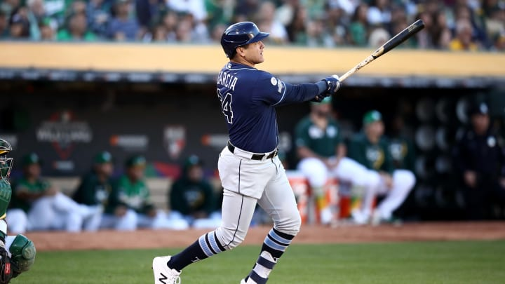 OAKLAND, CALIFORNIA - OCTOBER 02:  Avisail Garcia #24 of the Tampa Bay Rays hits a two-run home run off Sean Manaea #55 of the Oakland Athletics in the second inning of the American League Wild Card Game at RingCentral Coliseum on October 02, 2019 in Oakland, California.  (Photo by Ezra Shaw/Getty Images)