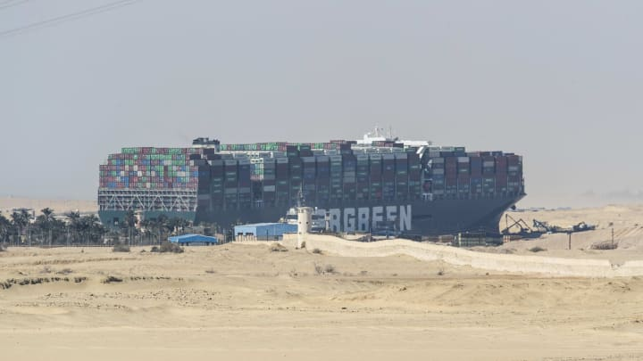 Work Continues To Free Container Ship Stuck In Suez Canal
