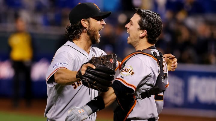 KANSAS CITY, MO - OCTOBER 29:  Buster Posey #28 and Madison Bumgarner #40 of the San Francisco Giants celebrate after defeating the Kansas City Royals to win Game Seven of the 2014 World Series by a score of 3-2 at Kauffman Stadium on October 29, 2014 in Kansas City, Missouri.  (Photo by Elsa/Getty Images)