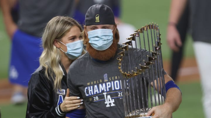 Justin Turner and his wife celebrate on the field after a positive result.