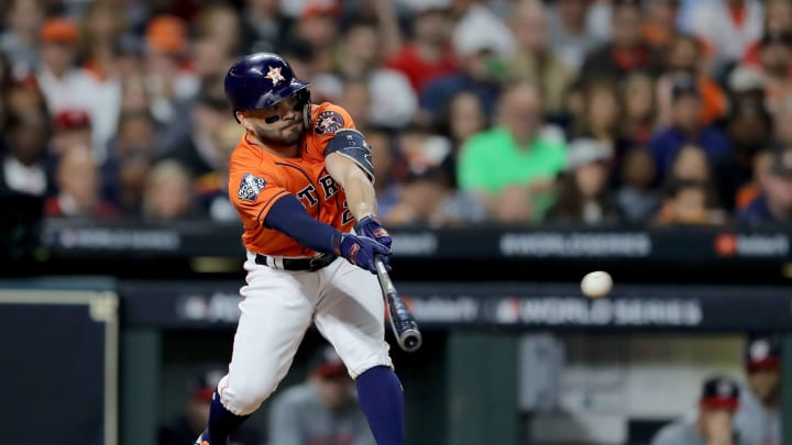 HOUSTON, TEXAS - OCTOBER 30:  Jose Altuve #27 of the Houston Astros singles against the Washington Nationals during the third inning in Game Seven of the 2019 World Series at Minute Maid Park on October 30, 2019 in Houston, Texas. (Photo by Elsa/Getty Images)