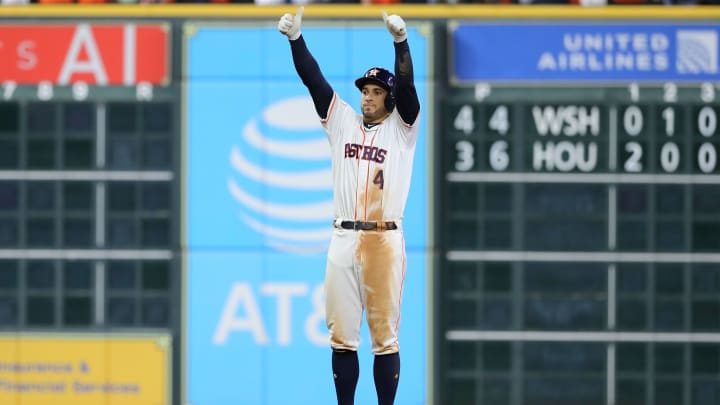 HOUSTON, TEXAS - OCTOBER 22:  George Springer #4 of the Houston Astros celebrates after he hits an RBI double against the Washington Nationals during the eighth inning in Game One of the 2019 World Series at Minute Maid Park on October 22, 2019 in Houston, Texas. (Photo by Elsa/Getty Images)