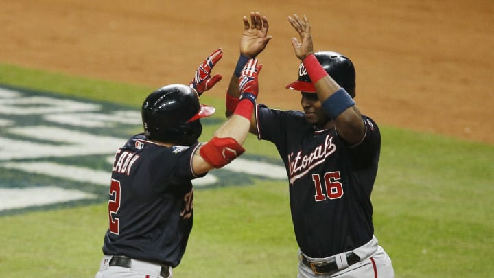 HOUSTON, TEXAS - OCTOBER 23:  Adam Eaton #2 of the Washington Nationals is congratulated by his teammate Victor Robles #16 after hitting a two-run home run against the Houston Astros during the eighth inning in Game Two of the 2019 World Series at Minute Maid Park on October 23, 2019 in Houston, Texas. (Photo by Bob Levey/Getty Images)