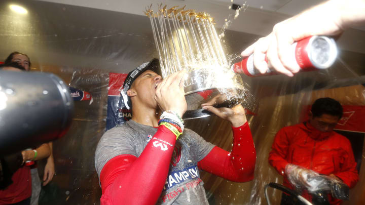 HOUSTON, TEXAS - OCTOBER 30:  Juan Soto #22 of the Washington Nationals celebrates in the locker room after defeating the Houston Astros in Game Seven to win the 2019 World Series at Minute Maid Park on October 30, 2019 in Houston, Texas. The Washington Nationals defeated the Houston Astros with a score of 6 to 2. (Photo by Elsa/Getty Images)