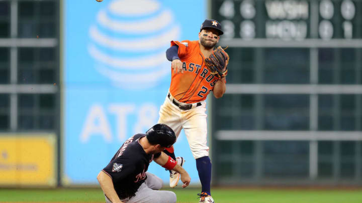 HOUSTON, TEXAS - OCTOBER 30:  Jose Altuve #27 of the Houston Astros gets the force out against Ryan Zimmerman #11 of the Washington Nationals during the ninth inning in Game Seven of the 2019 World Series at Minute Maid Park on October 30, 2019 in Houston, Texas. (Photo by Elsa/Getty Images)