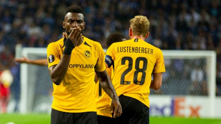Young Boys's player Roger Assalé (R) celebrates after...