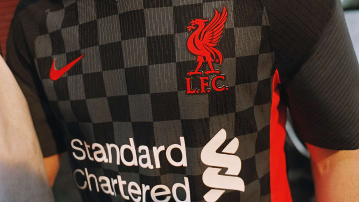 Liverpool's new third shirt is a nod to Anfield flags and banners