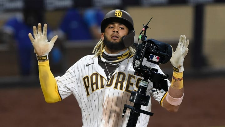 Tatis asked the robot ump to catch these Gold Gloves