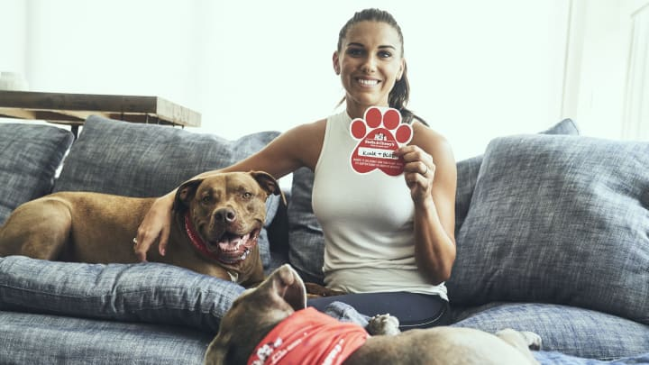 Alex Morgan with her rescue dogs.
