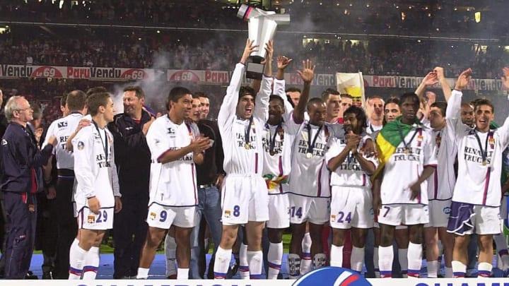 Juninho holds the Ligue 1 trophy aloft