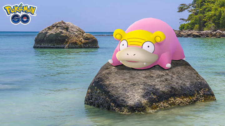 A wild Galarian Slowpoke rests on a rock.