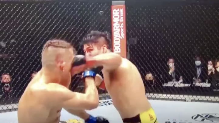 Vicente Luque delivers a flush left hook to the face of Niko Price at UFC 249 in their welterweight fight