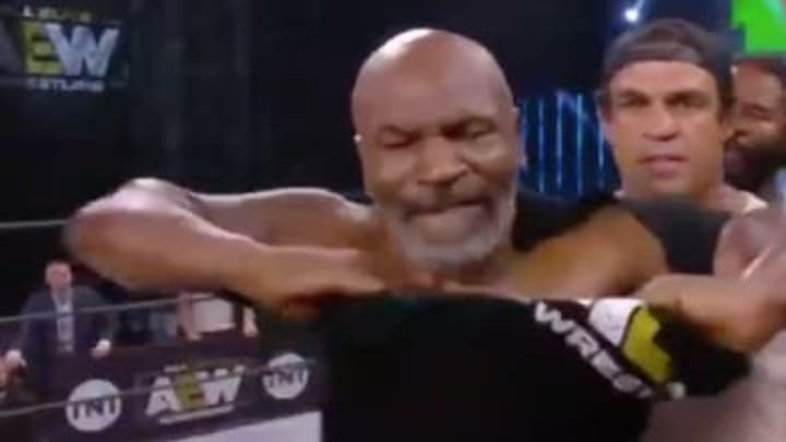 Boxing legend Mike Tyson struggled to rip his shirt off on AEW Dynamite.