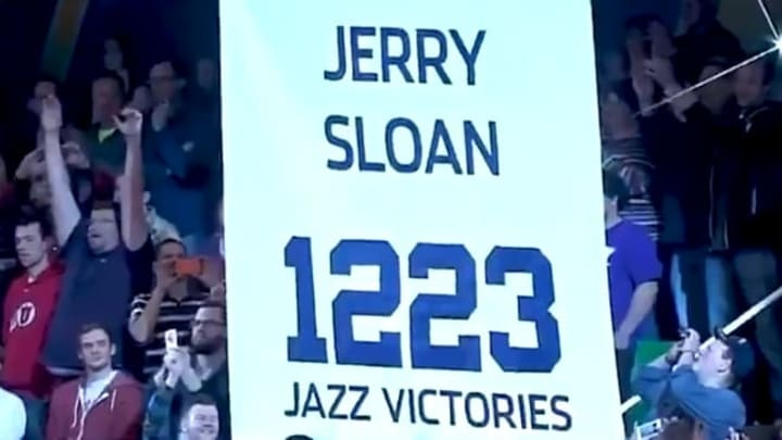 The Jazz raising a banner to honor Jerry Sloan's 1,223 wins as a head coach, the fourth most ever.