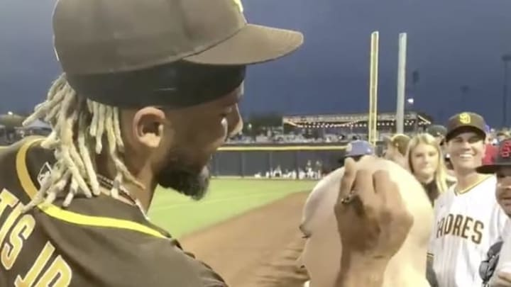 San Diego Padres SS Fernando Tatis signs a cancer patient's head upon her request at Spring Training.