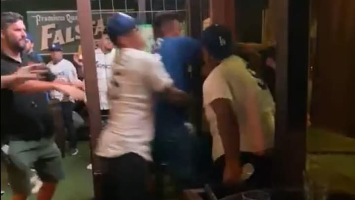 Los Angeles Dodgers fans brawl with each other inside Little Woodrow's bar in Houston