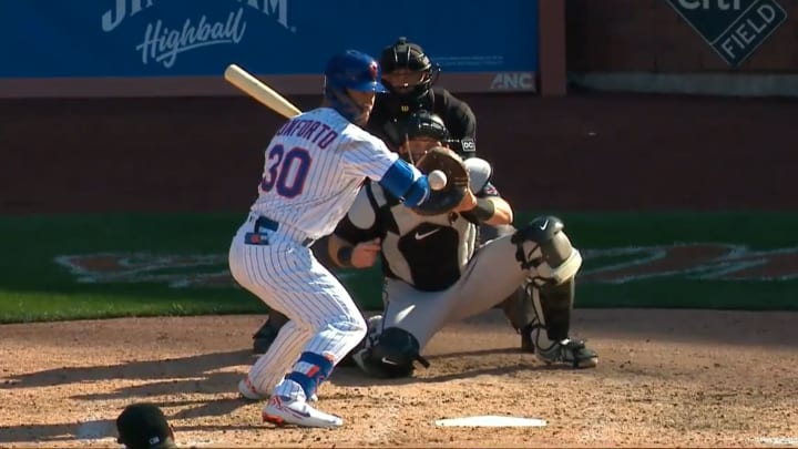 Michael Conforto leans in to get hit by a pitch for the New York Mets