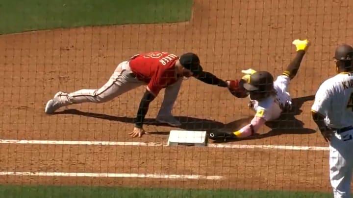Fernando Tatis Jr. avoids a tag a first base