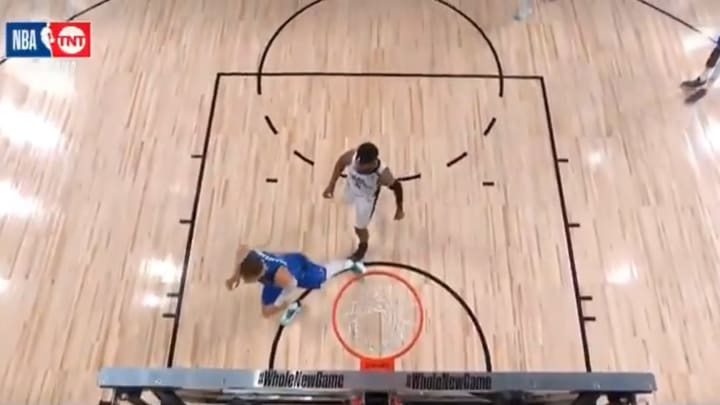 Marcus Morris steps on Luka Doncic's injured ankle