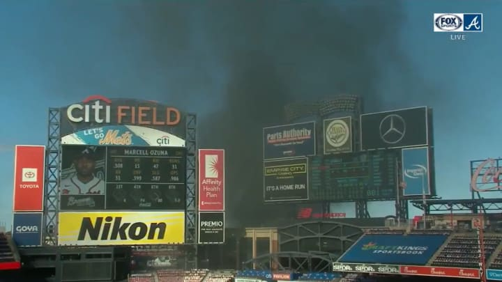 A fire outside Citi Field during a Mets-Braves game.
