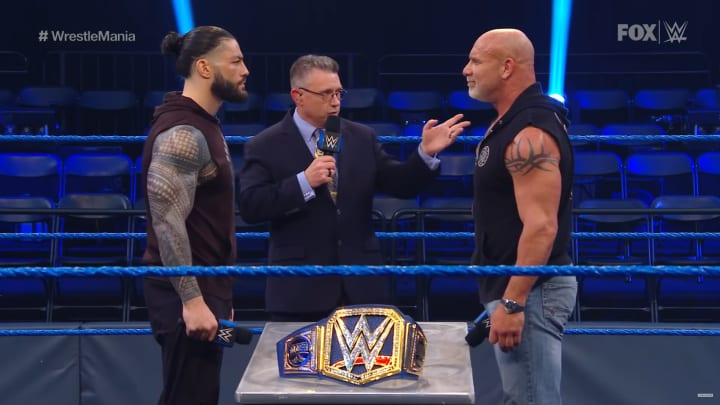 Roman Reigns and Goldberg face-off over the WWE Universal Title