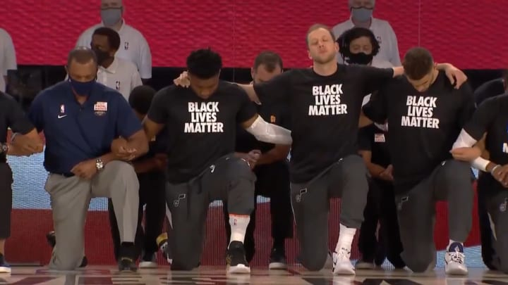 NBA players kneel during national anthem on league's first night back to action