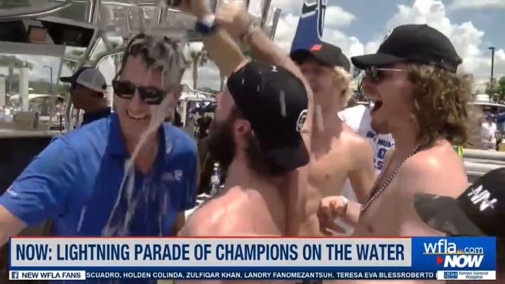Nikita Kucherov pours beer on WFLA's Josh Benson during Tampa Bay Lightning Stanley Cup boat parade