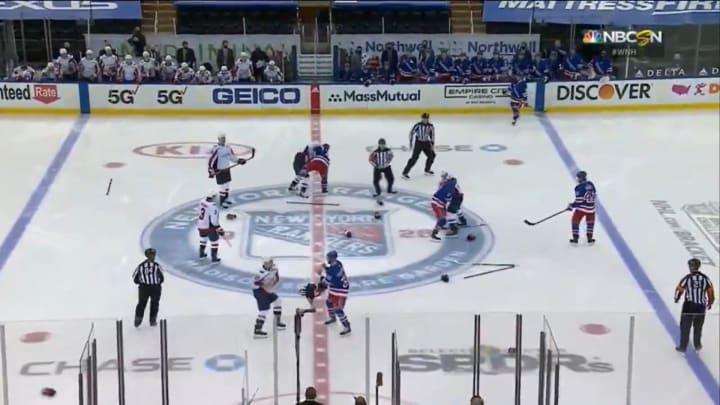 The New York Rangers and Washington Capitals brawl at center ice
