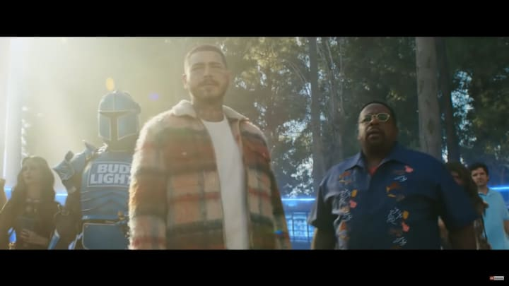 """Post Malone and Cedric the Entertaining in the """"Bud Light Legends"""" Super Bowl LV commercial"""