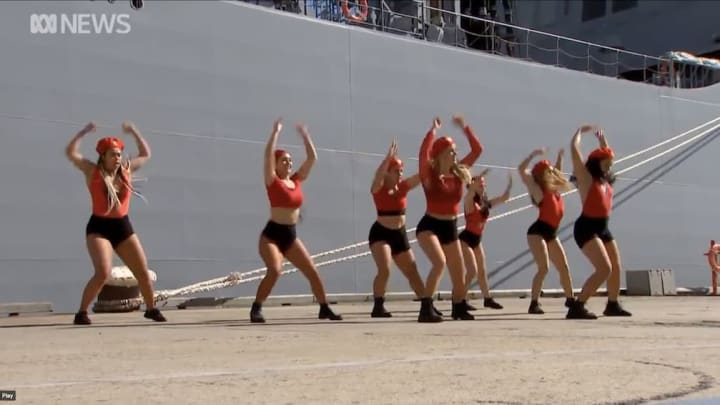 Dancers help commission an Australian Naval ship.