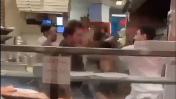 Pizza shop brawl.